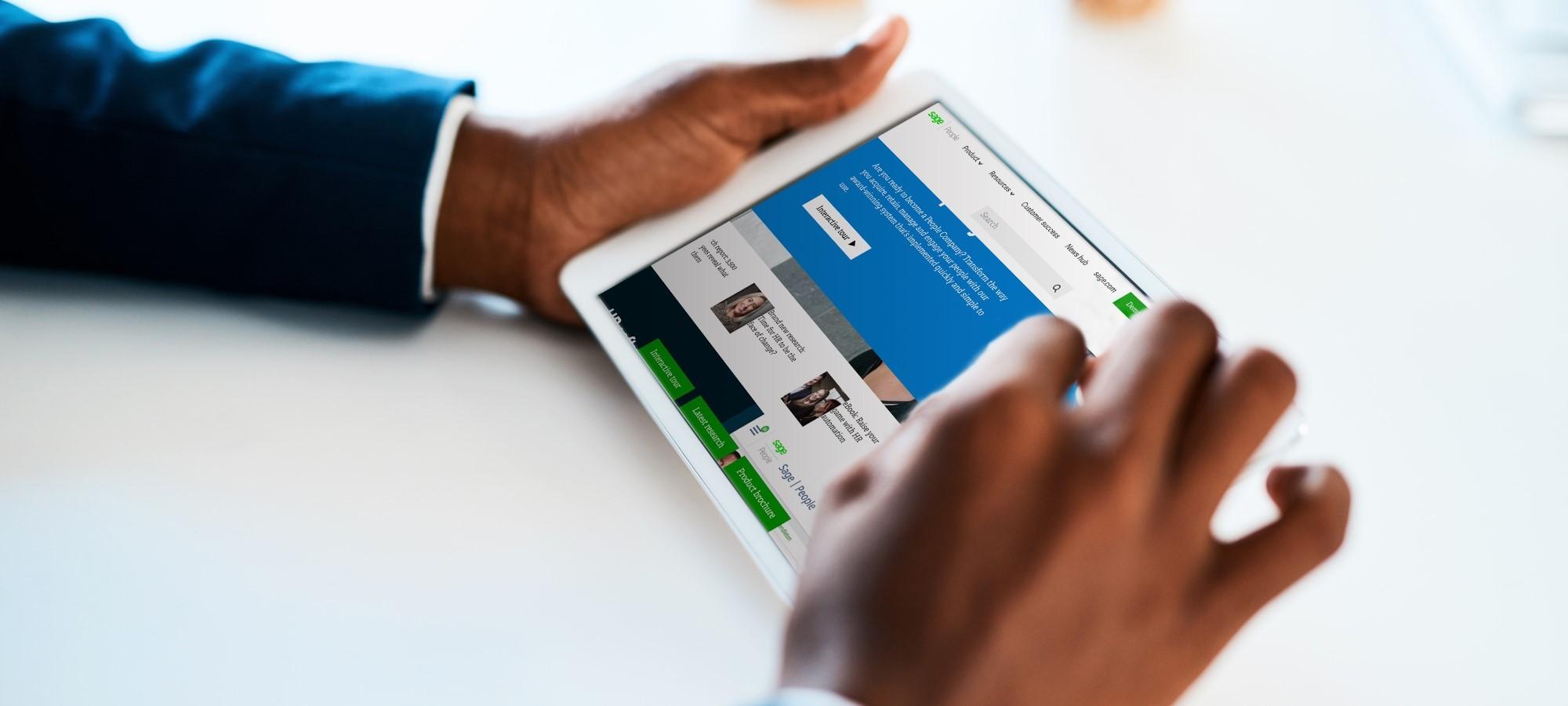 Person browsing Sagepeople website on tablet
