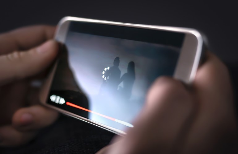 user watching video on device